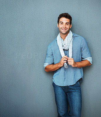 Buy stock photo Handsome man tugging on scarf