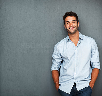 Buy stock photo Handsome man casually leaning against the wall