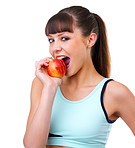 Fitness girl biting a red apple