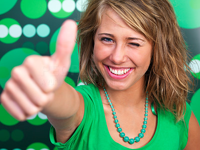 Happy young woman showing thumb\'s up sign