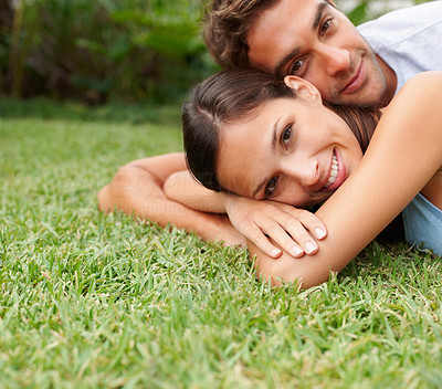 Buy stock photo Handsome man and woman lying in the grass