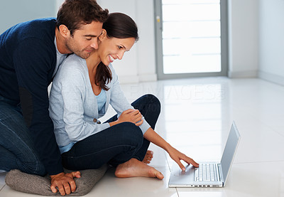 Buy stock photo Affectionate couple looking at laptop