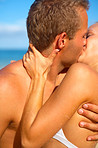 A Young Couple Kissing on the Beach