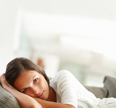 Buy stock photo Pretty woman on sofa looking vulnerable