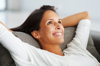 Buy stock photo Pretty woman on sofa smiling