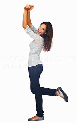 Buy stock photo Full-frame woman dancing with arms up and kicking leg out