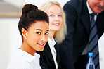 Young business woman with colleagues in the background