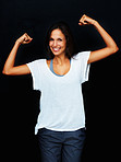 Woman flexing arms to display strength