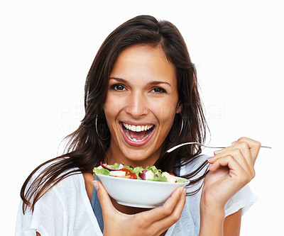 Buy stock photo Woman holding bowl of salad against white background