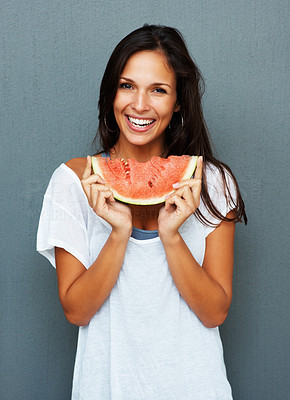 Buy stock photo Woman against blue background holding watermelon
