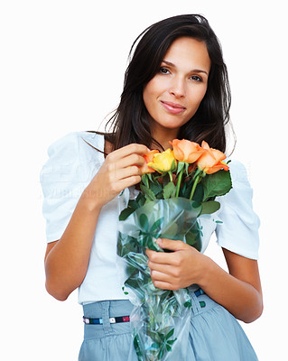 Buy stock photo Sensual woman holding flowers against white background