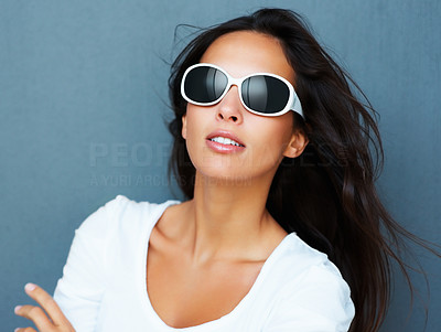 Buy stock photo Pretty woman looking sultry wearing sunglasses