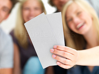 Young guys and girls looking at blank card