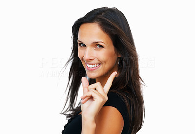 Buy stock photo Woman looking to camera and pointing upwards against white background