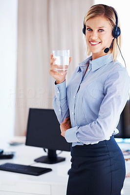 Smiling representative with glass of water