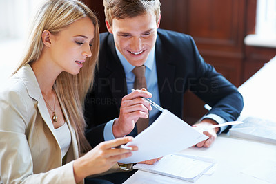Buy stock photo Portrait of happy business executives discussing about document at office
