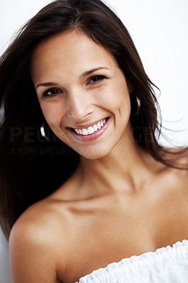 Buy stock photo Closeup portrait of a cute young lady smiling against white background