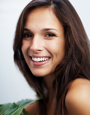 Buy stock photo Closeup portrait of a smiling young woman looking confidently