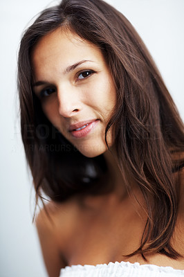 Buy stock photo Closeup portrait of a pretty young woman looking confidently