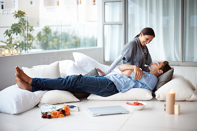 Buy stock photo Portrait of a happy young couple relaxing in living room - Indoor