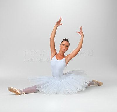 Buy stock photo Full length of a young ballerina performing against white background - copyspace