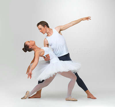 Buy stock photo Portrait of two ballet dancers posing against white background - copyspace