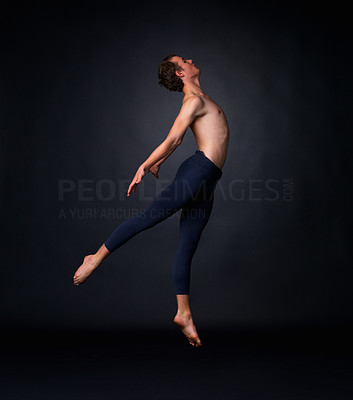 Buy stock photo Full length of a young ballet dancer flying against black background