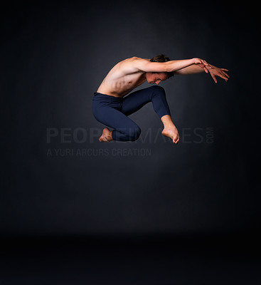 Buy stock photo Full length of a young ballet man jumping high against black background - copyspace