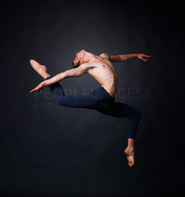 Buy stock photo Portrait of a graceful male dancer performing against black background