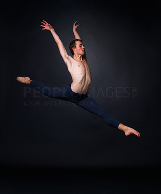 Buy stock photo Full length of a male ballet dancer leaping against black background - copyspace