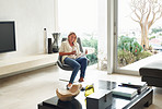 Woman sitting in chair at beautiful living room in modern home