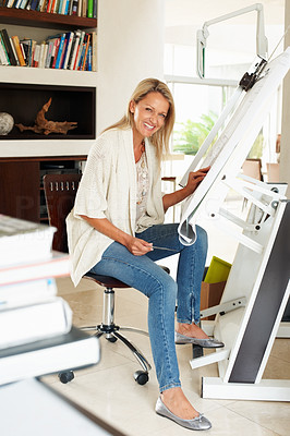 Buy stock photo Portrait of a happy female architect working on construction plans on board