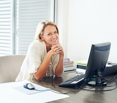 Buy stock photo Attractive smiling mature business woman with computer at work desk