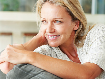 Buy stock photo Closeup portrait of a beautiful mature woman smiling over a thought