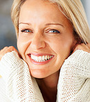 Closeup portrait of a gray eyed mature woman smiling