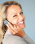 Happy woman using a cellphone while giving you a smile