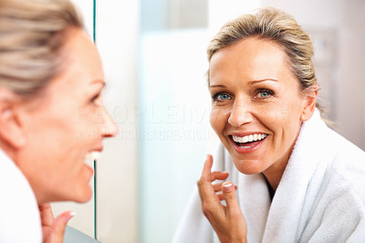 Buy stock photo Close-up of a happy mature lady looking in mirror