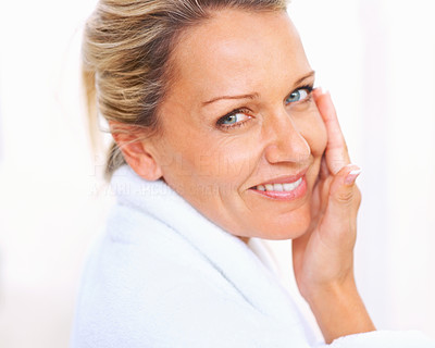 Buy stock photo Closeup portrait of a pretty mature woman giving you a warm smile against white background