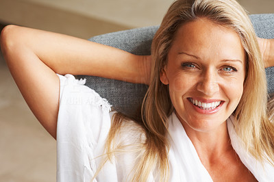 Buy stock photo Closeup portrait of a happy relaxed mature woman smiling