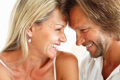 Buy stock photo Closeup portrait of a romantic mature couple head to head smiling