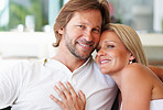 Closeup portrait of a loving relaxed mature couple smiling