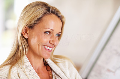 Buy stock photo Closeup portrait of a mature woman with a cute friendly smile , looking away