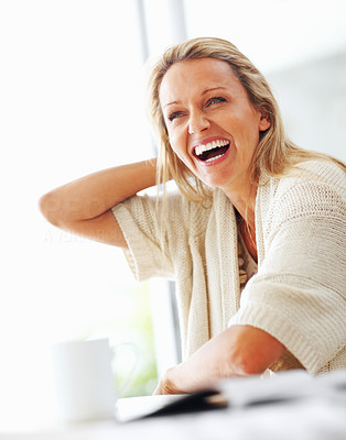 Buy stock photo Portrait of a happy cheerful mature female laughing