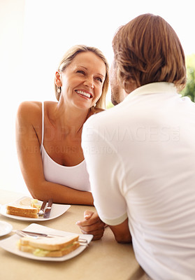 Buy stock photo Portrait of a loving mature couple looking at each other during breakfast