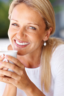 Buy stock photo Closeup portrait of a happy mature woman holding a cup of tea