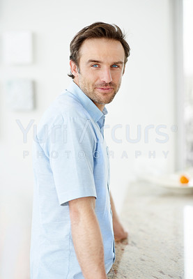 Buy stock photo Portrait of a happy young man standing by kitchen counter at home - Indoor