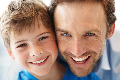 Buy stock photo Closeup portrait of a happy young man and his son together