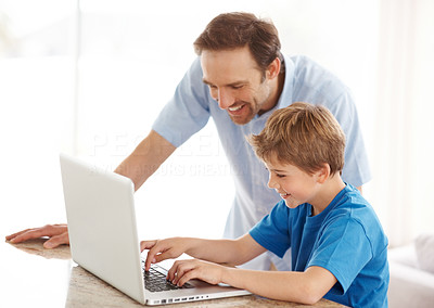 Buy stock photo Portrait of a happy young man and his son working on laptop - Indoor