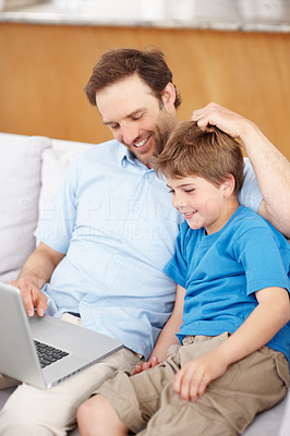 Buy stock photo Portrait of a father and son sitting on sofa using laptop - Indoor