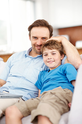 Buy stock photo Portrait of a happy young father and son relaxing together on couch with a laptop  - Indoor
